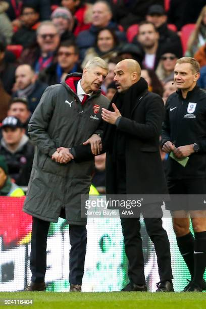 Arsene Wenger manager of Arsenal and Pep Guardiola the head coach / manager of Manchester City have a disagreeement during the Carabao Cup Final...