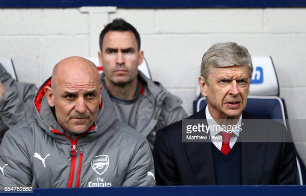 Arsene Wenger Manager of Arsenal and Steve Bould assistant manger of Arsenal looks on from the bench during the Premier League match between West...