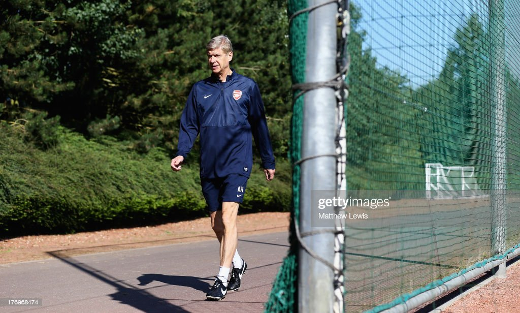 Arsene Wenger, manager of Arsenal arrives ahead of a training session ahead of their UEFA Champions League Play Off first leg match against Fenerbache at London Colney on August 20, 2013 in St Albans, England.