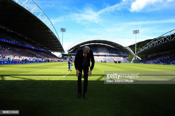 Arsene Wenger manager of Arsenal bfs to the fans before his final game in charge during the Premier League match between Huddersfield Town and...