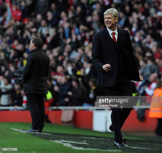 Arsene Wenger manager of Arsenal celebrates after his team scores the opening goal during the FA Cup Fifth Round match between Arsenal and Liverpool...