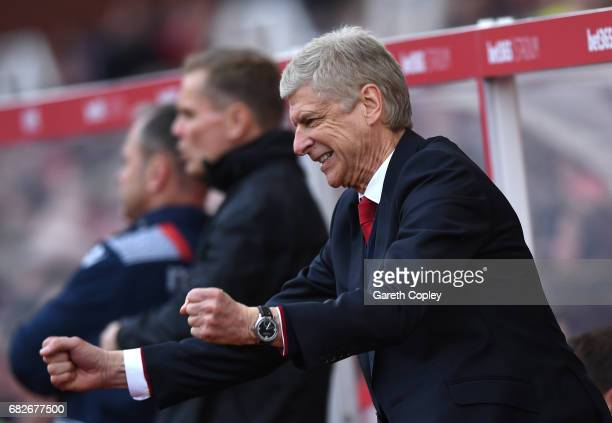 Arsene Wenger Manager of Arsenal celebrates his sides second goal during the Premier League match between Stoke City and Arsenal at Bet365 Stadium on...