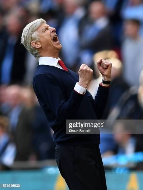 Arsene Wenger manager of Arsenal celebrates his team's 21 victory at the final whistle during the Emirates FA Cup SemiFinal match between Arsenal and...