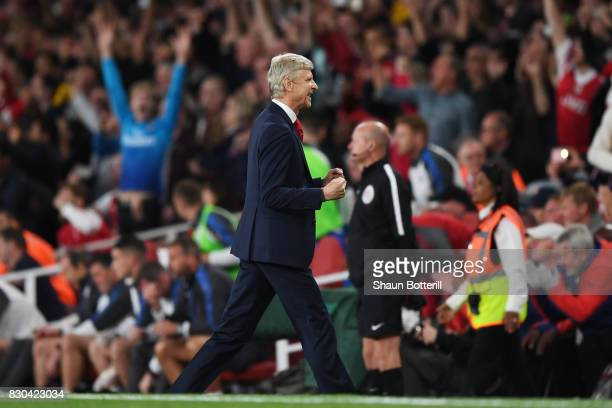 Arsene Wenger Manager of Arsenal celebrates his team's 43 victory during the Premier League match between Arsenal and Leicester City at the Emirates...