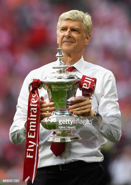 Arsene Wenger Manager of Arsenal celebrates with The FA Cup after The Emirates FA Cup Final between Arsenal and Chelsea at Wembley Stadium on May 27...