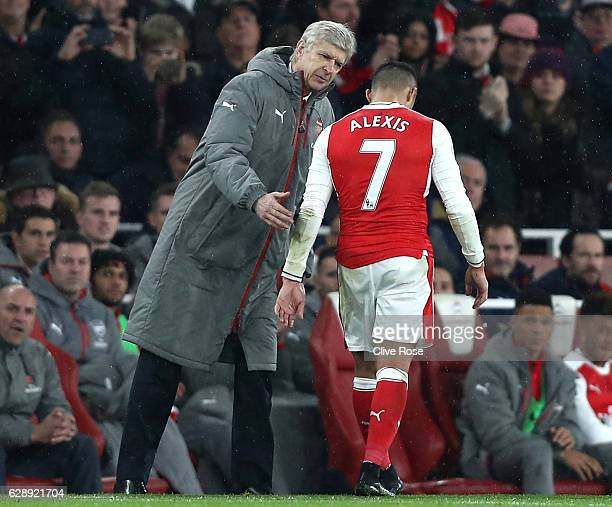 Arsene Wenger Manager of Arsenal embraces Alexis Sanchez of Arsenal after he is subbed during the Premier League match between Arsenal and Stoke City...
