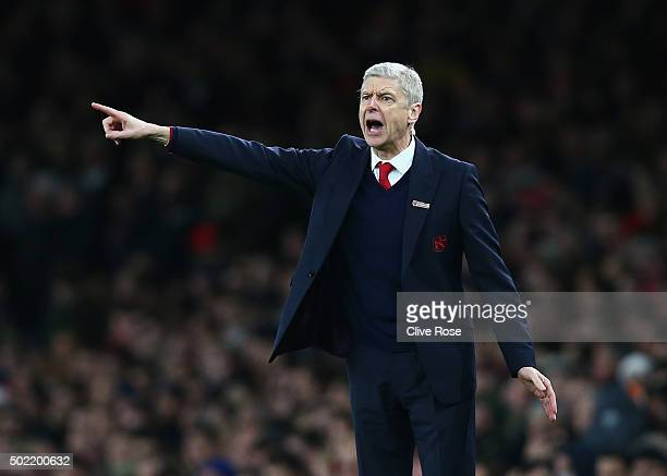 Arsene Wenger manager of Arsenal gives instructions during the Barclays Premier League match between Arsenal and Manchester City at Emirates Stadium...