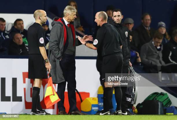 Arsene Wenger Manager of Arsenal in discussion with referee Mike Dean during the Premier League match between West Bromwich Albion and Arsenal at The...