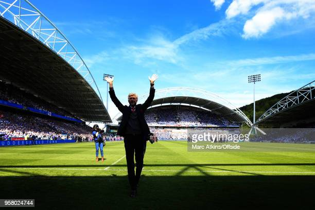 Arsene Wenger manager of Arsenal in front of the fans before his final game in charge during the Premier League match between Huddersfield Town and...