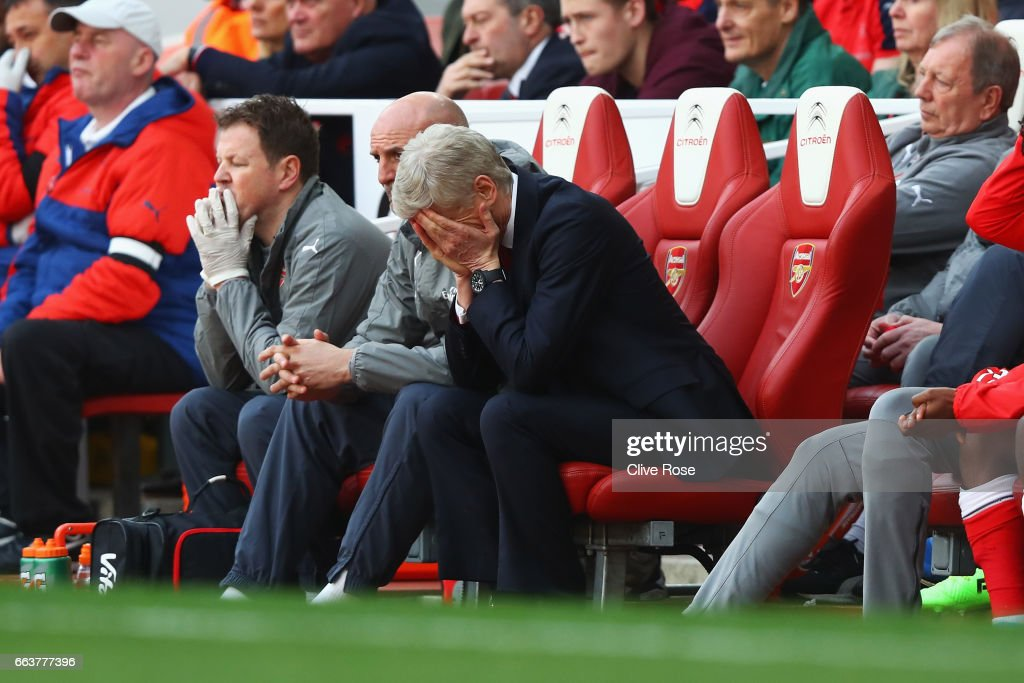 Arsene Wenger, Manager of Arsenal is dejected after the Premier League match between Arsenal and Manchester City at Emirates Stadium on April 2, 2017 in London, England.