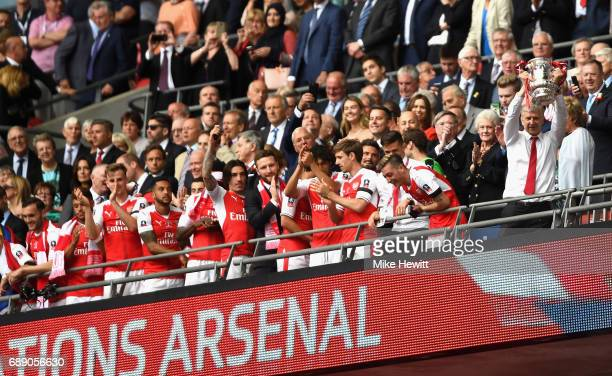 Arsene Wenger Manager of Arsenal lifts The FA Cup after The Emirates FA Cup Final between Arsenal and Chelsea at Wembley Stadium on May 27 2017 in...