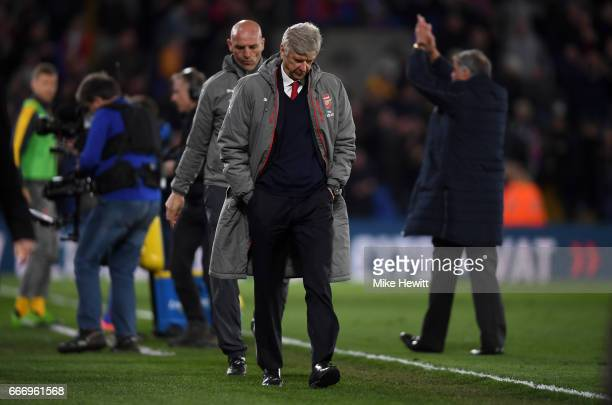Arsene Wenger Manager of Arsenal looks dejected in defeat after the Premier League match between Crystal Palace and Arsenal at Selhurst Park on April...