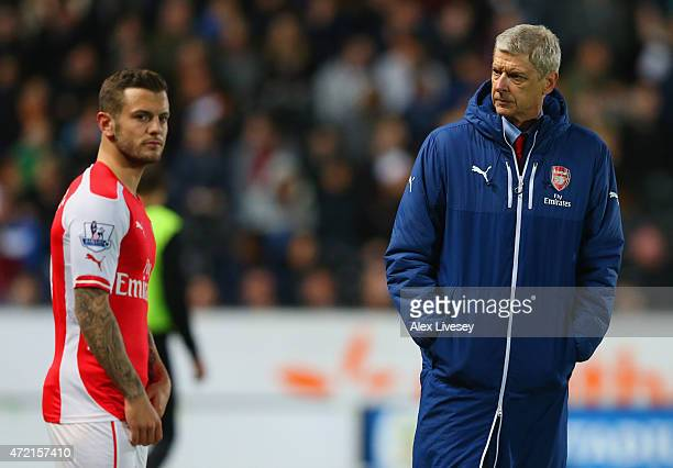 Arsene Wenger manager of Arsenal looks on as Jack Wilshere of Arsenal prepares to come onto the pitch during the Barclays Premier League match...