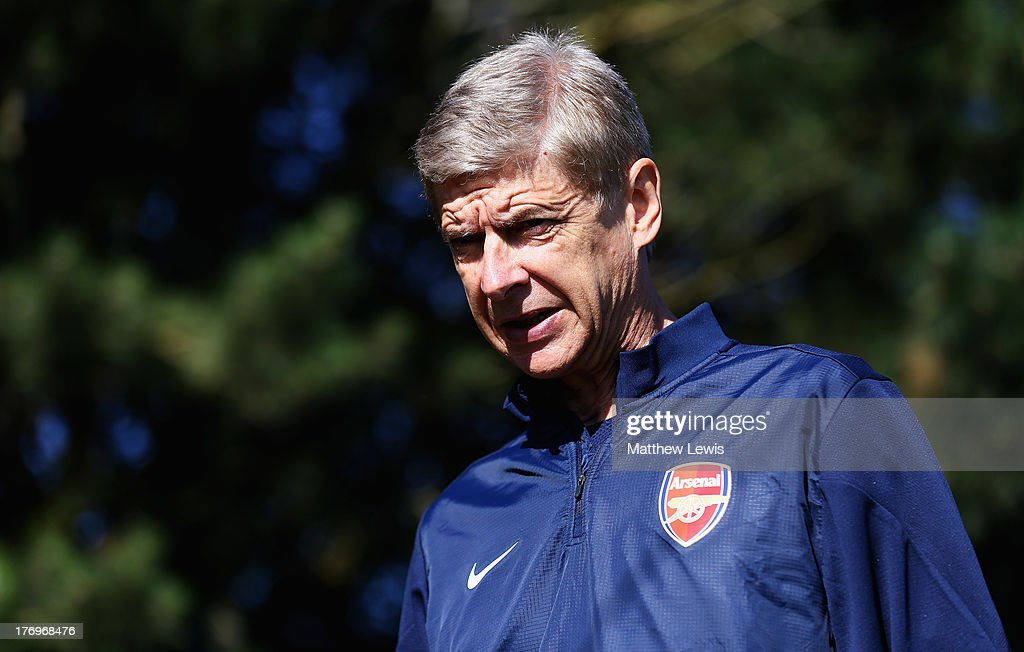 Arsene Wenger, manager of Arsenal looks on during a training session ahead of their UEFA Champions League Play Off first leg match against Fenerbache at London Colney on August 20, 2013 in St Albans, England.