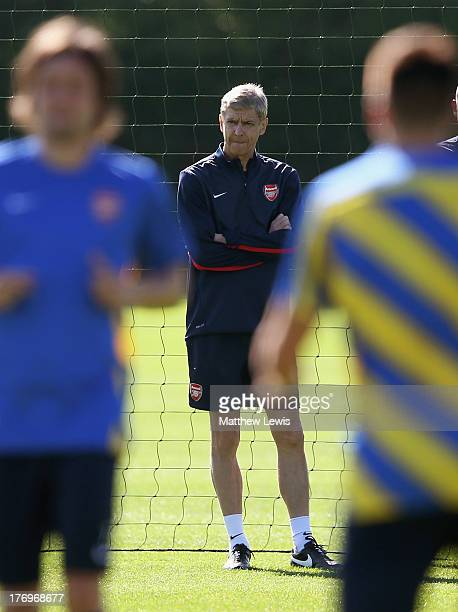 Arsene Wenger manager of Arsenal looks on during a training session ahead of their UEFA Champions League Play Off first leg match against Fenerbache...