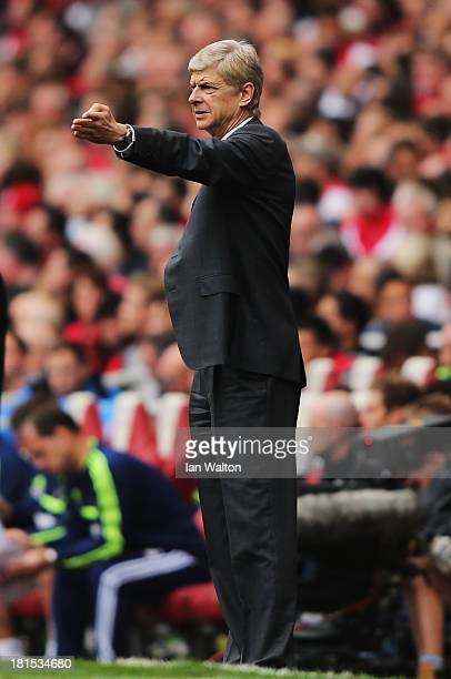 Arsene Wenger manager of Arsenal looks on during the Barclays Premier League match between Arsenal and Stoke City at Emirates Stadium on September 22...