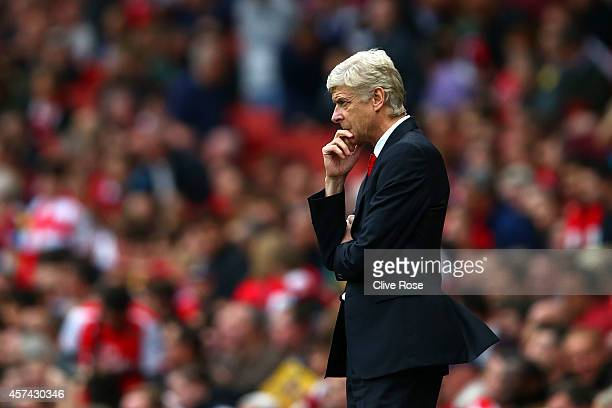 Arsene Wenger manager of Arsenal looks on during the Barclays Premier League match between Arsenal and Hull City at Emirates Stadium on October 18...