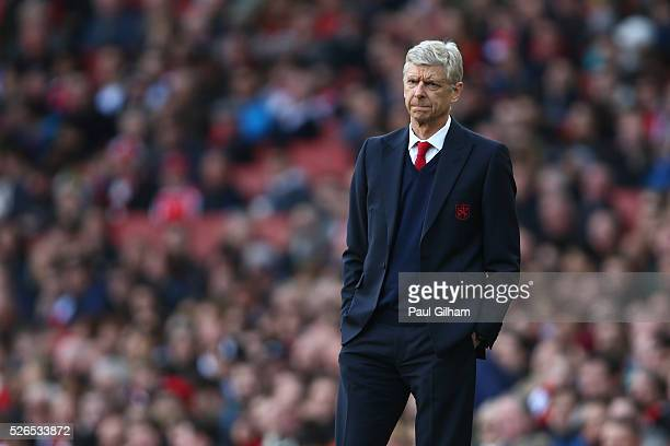 Arsene Wenger Manager of Arsenal looks on during the Barclays Premier League match between Arsenal and Norwich City at The Emirates Stadium on April...