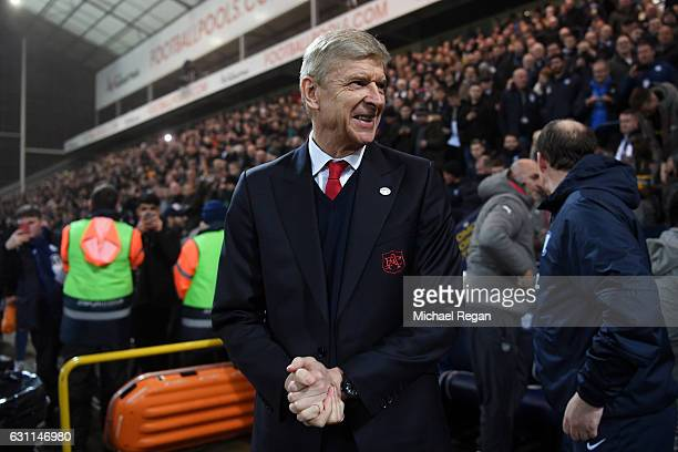 Arsene Wenger Manager of Arsenal looks on during the Emirates FA Cup Third Round match between Preston North End and Arsenal at Deepdale on January 7...