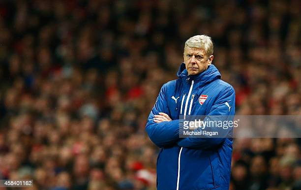 Arsene Wenger manager of Arsenal looks on during the UEFA Champions League Group D match between Arsenal FC and RSC Anderlecht at Emirates Stadium on...