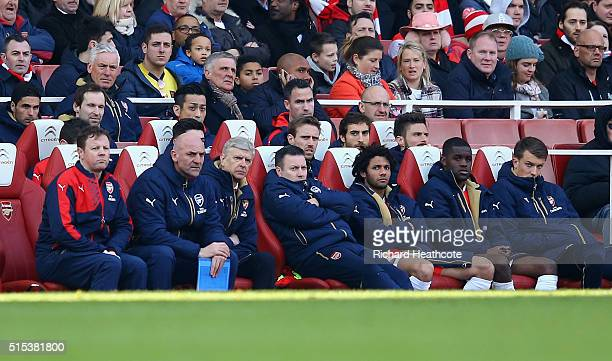 Arsene Wenger manager of Arsenal looks on from the team bench with coaching staff and players during the Emirates FA Cup sixth round match between...