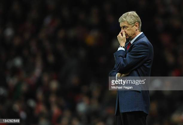 Arsene Wenger manager of Arsenal looks thoughtful during the Carling Cup Quarter Final match between Arsenal and Manchester City at Emirates Stadium...