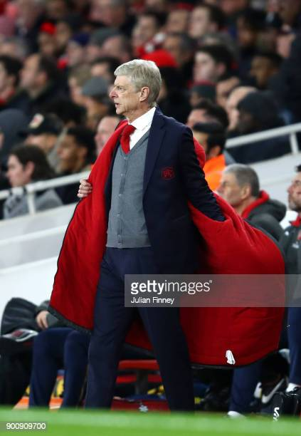 Arsene Wenger, Manager of Arsenal puts his coat on during the Premier League match between Arsenal and Chelsea at Emirates Stadium on January 3, 2018...
