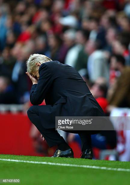 Arsene Wenger manager of Arsenal reacts during the Barclays Premier League match between Arsenal and Hull City at Emirates Stadium on October 18 2014...