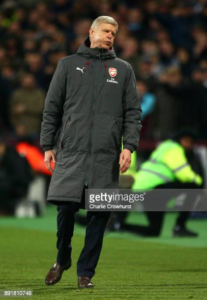 Arsene Wenger Manager of Arsenal reacts during the Premier League match between West Ham United and Arsenal at London Stadium on December 13 2017 in...