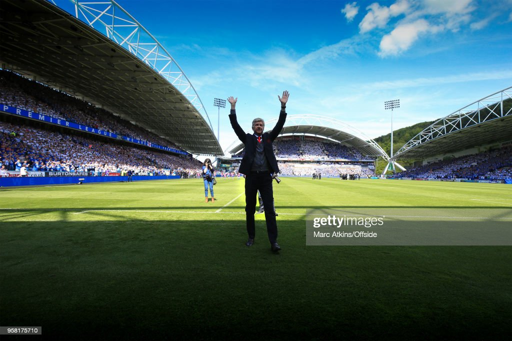 Arsene Wenger manager of Arsenal salutes the fans before his last game in charge during the Premier League match between Huddersfield Town and Arsenal at John Smith's Stadium on May 13, 2018 in Huddersfield, England.