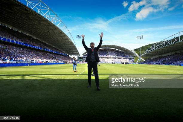 Arsene Wenger manager of Arsenal salutes the fans before his last game in charge during the Premier League match between Huddersfield Town and...