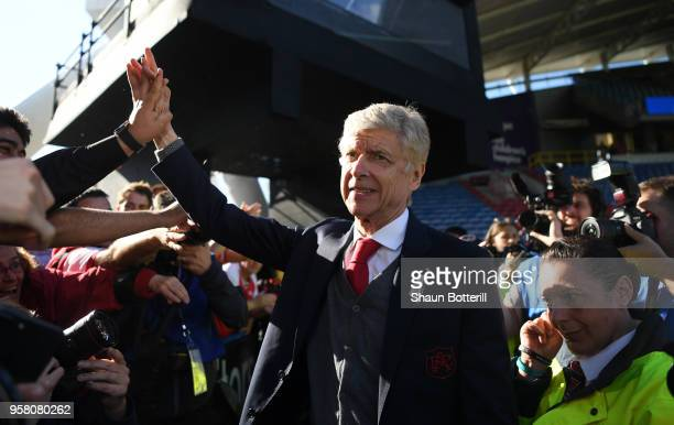 Arsene Wenger Manager of Arsenal shows appreciation to the fans after the Premier League match between Huddersfield Town and Arsenal at John Smith's...