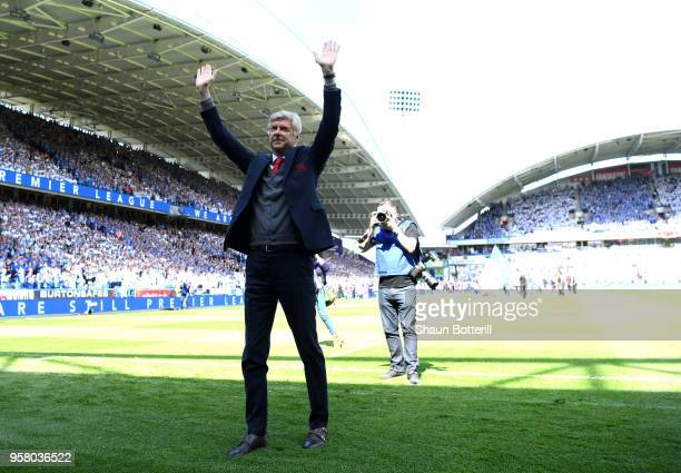 Arsene Wenger Manager of Arsenal shows appreciation to the fans prior to the Premier League match between Huddersfield Town and Arsenal at John...