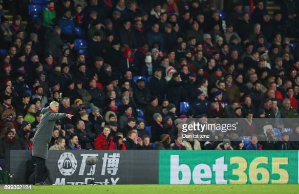 Arsene Wenger Manager of Arsenal signals from the touchline during the Premier League match between Crystal Palace and Arsenal at Selhurst Park on...