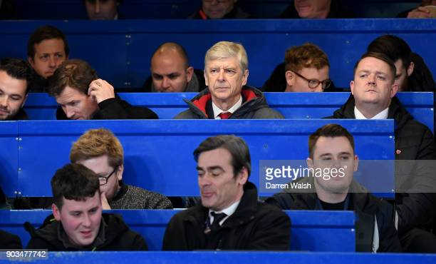 Arsene Wenger Manager of Arsenal sits in the stands during the Carabao Cup SemiFinal First Leg match between Chelsea and Arsenal at Stamford Bridge...