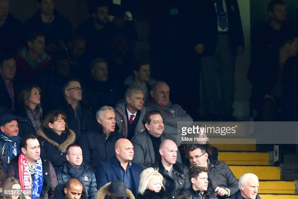 Arsene Wenger manager of Arsenal sits in the stands with the fans as he continues to serve his touchline ban during the Premier League match between...