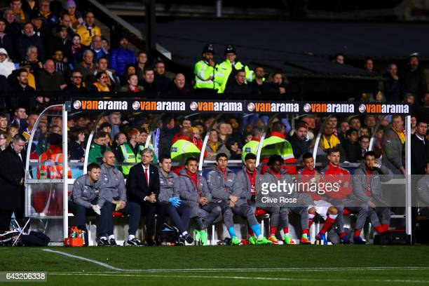 Arsene Wenger manager of Arsenal sits on the bench with his coaching staff and substitutes before the Emirates FA Cup fifth round match between...