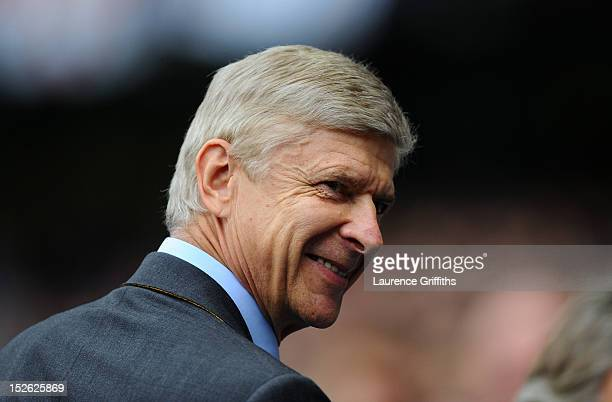 Arsene Wenger manager of Arsenal smiles ahead of the Barclays Premier League match between Manchester City and Arsenal at Etihad Stadium on September...