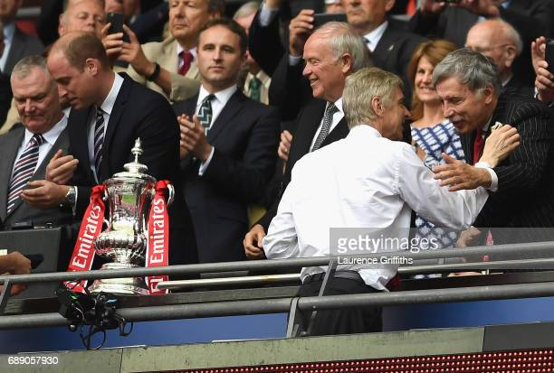 Arsene Wenger Manager of Arsenal speaks to Stan Kroenke Arsenal owner after The Emirates FA Cup Final between Arsenal and Chelsea at Wembley Stadium...