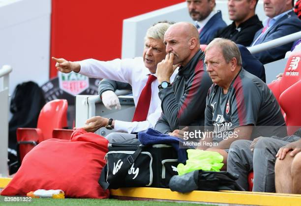 Arsene Wenger Manager of Arsenal speaks to Steve Bould Arsenal asisstant maanger during the Premier League match between Liverpool and Arsenal at...