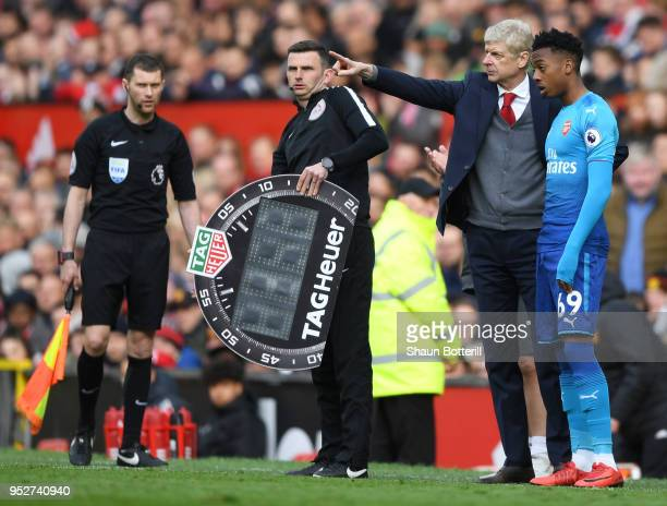 Arsene Wenger Manager of Arsenal speaks with Joseph Willock of Arsenal prior to being subtituted on during the Premier League match between...