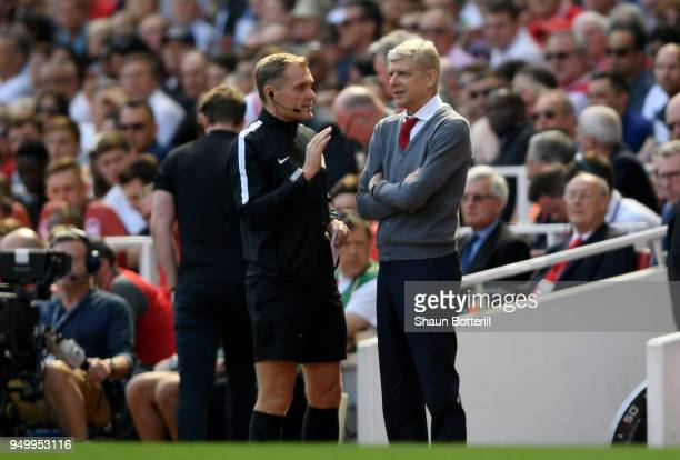 Arsene Wenger Manager of Arsenal speaks with the fourth official during the Premier League match between Arsenal and West Ham United at Emirates...
