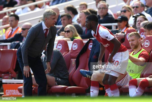 Arsene Wenger Manager of Arsenal talks to Ainsley MaitlandNiles of Arsenal during the Premier League match between Arsenal and West Ham United at...
