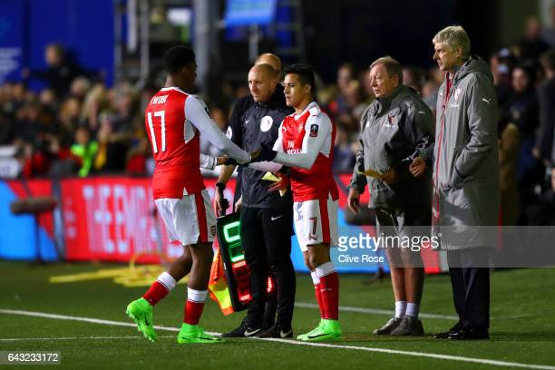 Arsene Wenger manager of Arsenal watches as Alexis Sanchez of Arsenal replaces Alex Iwobi of Arsenal during the Emirates FA Cup fifth round match...