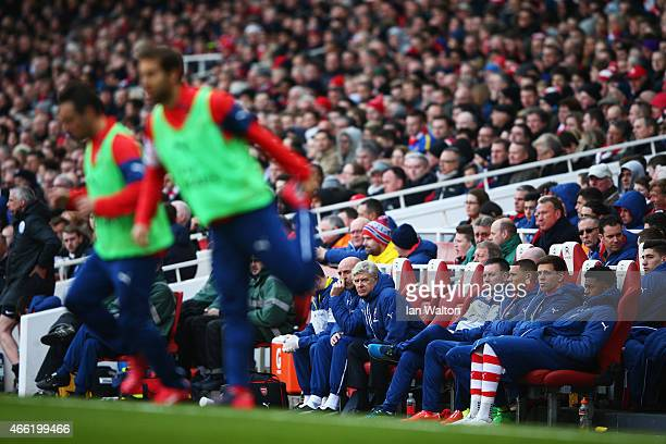 Arsene Wenger manager of Arsenal watches from the bench during the Barclays Premier League match between Arsenal and West Ham United at Emirates...