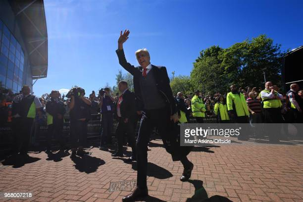 Arsene Wenger manager of Arsenal waves as he arrives at John Smith's Stadium during the Premier League match between Huddersfield Town and Arsenal at...
