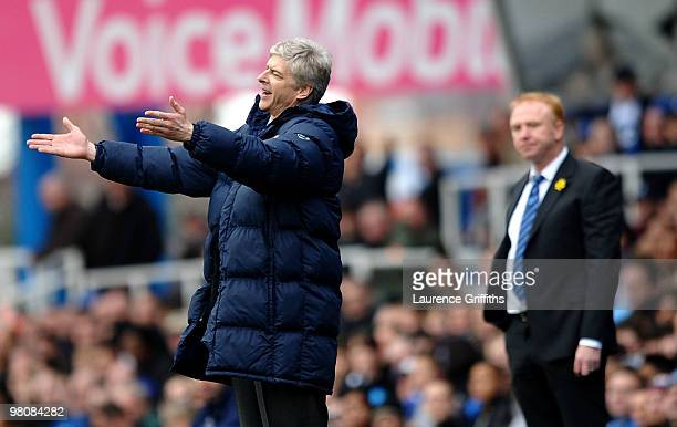 Arsene Wenger of Arsenal makes his feelings known from the touchline in front of Alex McLeish of Birmingham City during the Barclays Premier League...