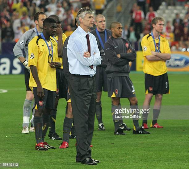 Arsene Wenger of Arsenal shows his dissapointment in front of his team as Barcelona lift the trophy during the UEFA Champions League Final between...