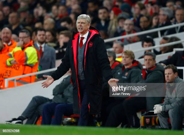Arsene Wenger of Arsenal shows his frustration during the UEFA Europa League Round of 16 Second Leg match between Arsenal and AC Milan at Emirates...