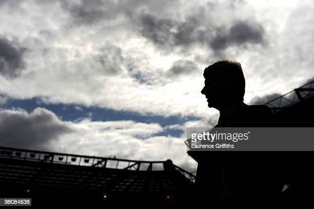 Arsene Wenger of Arsenal strides out in front of the home support before the Barclays Premier League match between Birmingham City and Arsenal at St...